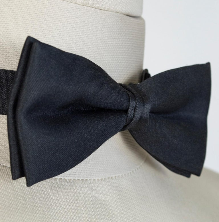 Does the thought of a black tie affair cause you enough angst without the added stress of tying your own bow tie? This pre-tied version will have you dressed and ready in a snap. Pair it with our vintage ivory dinner jacket (listed separately) and