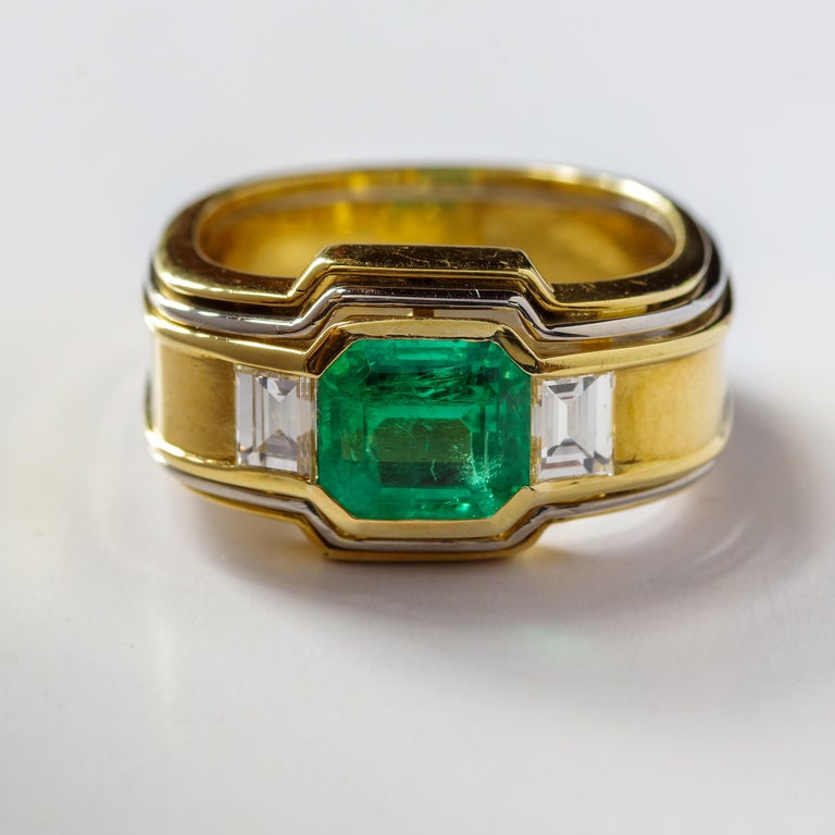 This had to have been designed by an architect. The perfection in its design is startling. First and foremost, this ring is constructed around an emerald of significant size and quality: an approximately 2.60 carat (9.2 mm x 7.73 mm) emerald in the