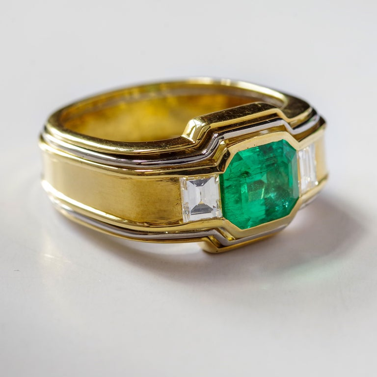 Art Deco Emerald Ring in 18 Karat Gold with Diamonds in Architectural Setting For Sale