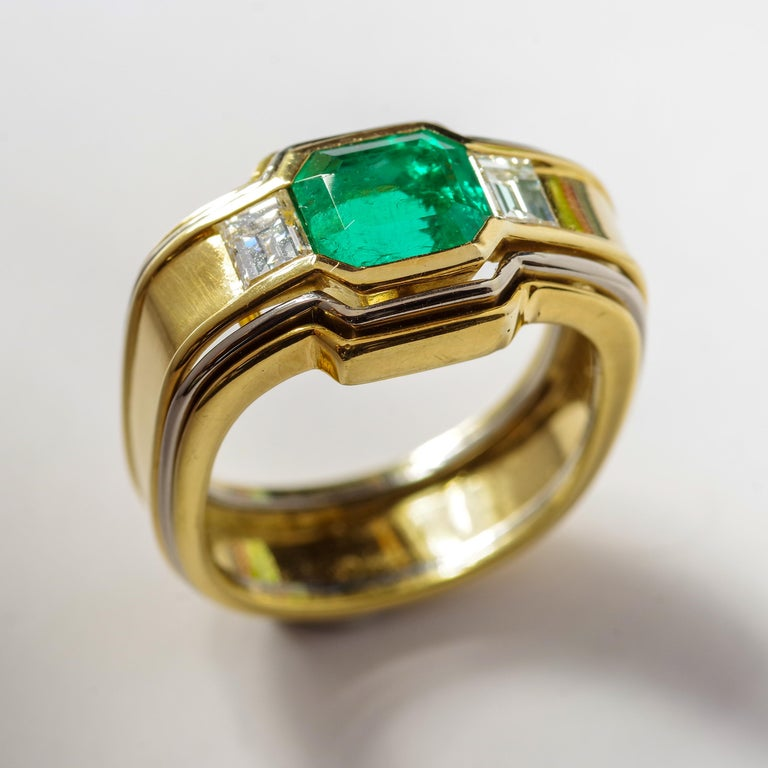 Emerald Cut Emerald Ring in 18 Karat Gold with Diamonds in Architectural Setting For Sale