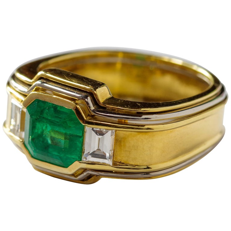 Emerald Ring in 18 Karat Gold with Diamonds in Architectural Setting For Sale