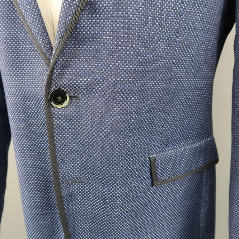 954800ebb54 Single breasted ETRO sport coat comes in a navy blue Nailhead print wool  linen blend fabric