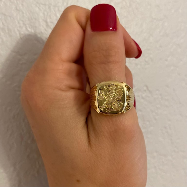 Fabulous Gent's Gold engraved half eagle, half lion Griffin Crest Signet Ring. Hand crafted in 14 Karat yellow Gold. Measuring approx. 0.90