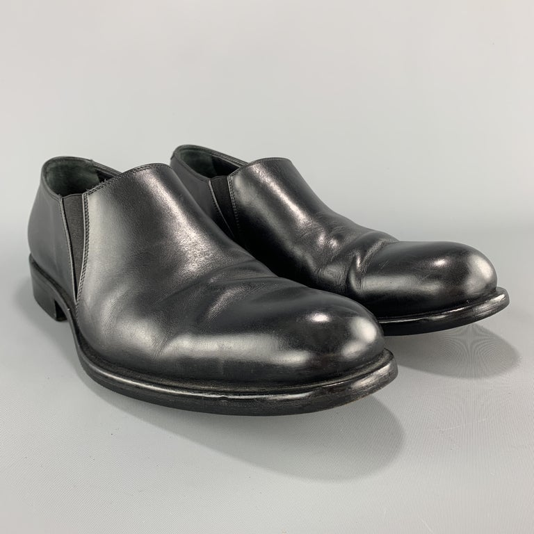 GIORGIO ARMANI loafer style dress shoes come in smooth black leather with a rounded point toe. Made in Italy.  Very Good Pre-Owned Condition. Marked: IT 42  Outsole: 11.75 x 4.25 in.