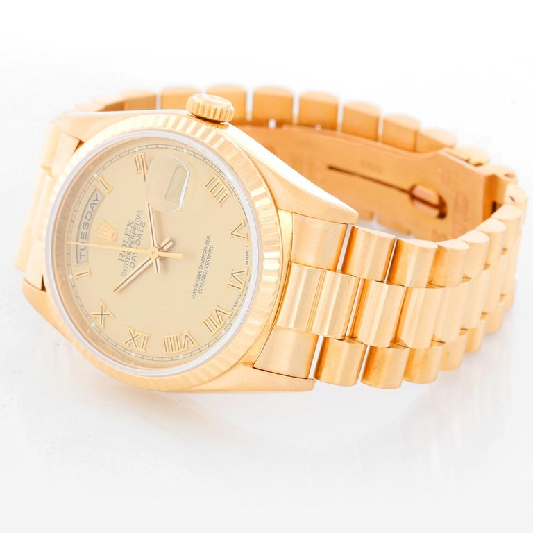 Men's Gold Rolex President Day-Date Watch 18238 - Automatic winding, 31 jewels, double Quickset, sapphire crystal. 18k yellow gold case and fluted bezel (36mm diameter). Champagne dial with Roman numerals. 18k yellow gold President bracelet.