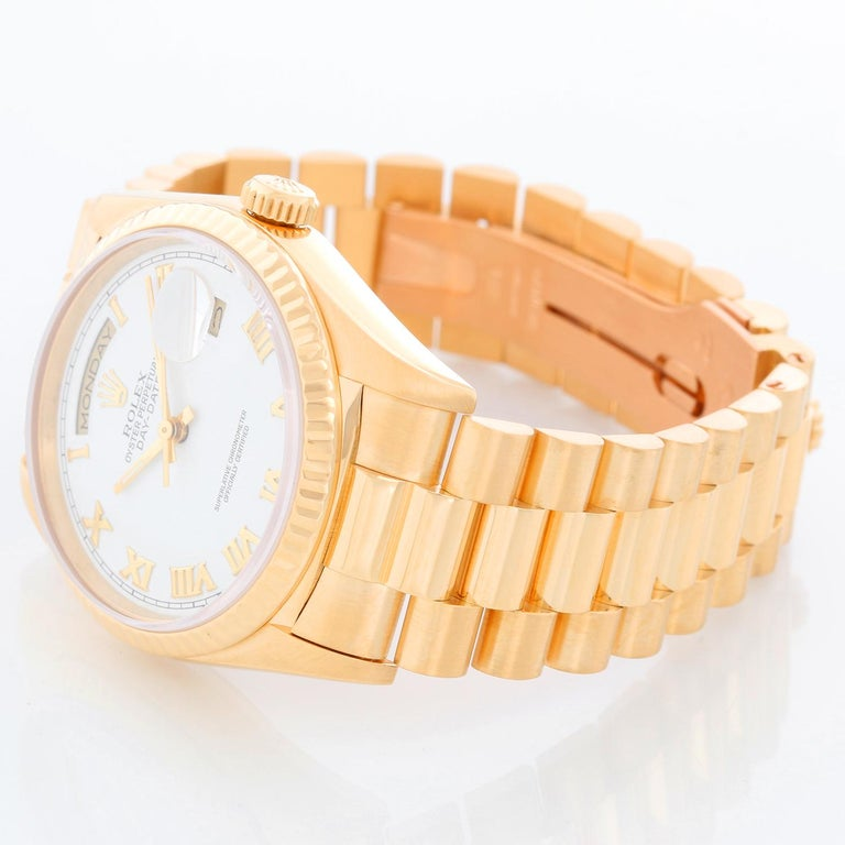 Men's Gold Rolex President Day-Date Watch 18238 - Automatic winding, 31 jewels, double Quickset, sapphire crystal. 18k yellow gold case and fluted bezel (36mm diameter). White dial with Roman numerals . 18k yellow gold President bracelet. Pre-owned