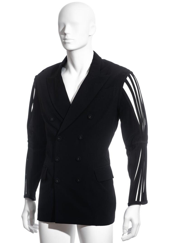 ▪ Men's Jean Paul Gaultier black double-breasted blazer jacket ▪ 100% Wool ▪ Caged sleeves  ▪ Peak lapels ▪ Provenance: Pete Burns (1959–2016) ▪ Size 48 ▪ Spring-Summer 1989