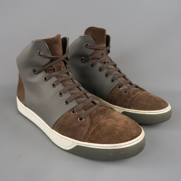 LANVIN high top sneakers come in brown suede with a dual tone rubber sole and gray rubber mid panel. Made in Italy.   Good Pre-Owned Condition. Marked: UK 7   Measurements:   Length: 11.5 in. Width: 4.25 in. Height: 5  in.