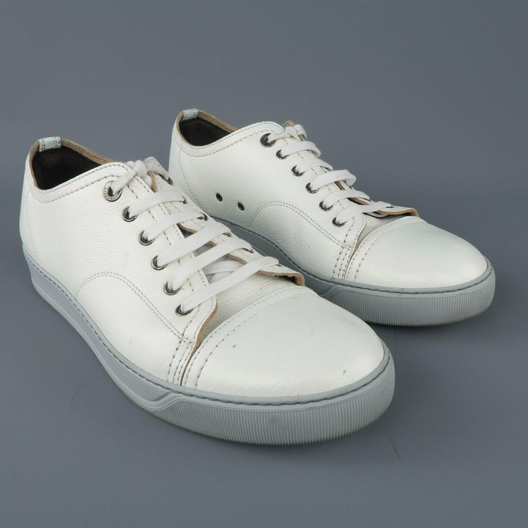 e9daa9642ba2 LANVIN low top sneakers come in a unique white textured leather with an  iridescent sheen and