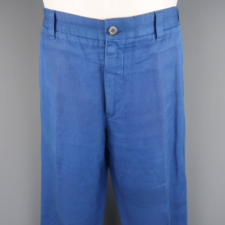 LORO PIANA chinos come in royal blue cotton canvas with a classic fit leg. Fading throughout. As-is. Made in Italy.   Fair Pre-Owned Condition. Marked: IT 50   Measurements:   Waist: 35 in. Rise: 10.5 in. Inseam: 33 in.