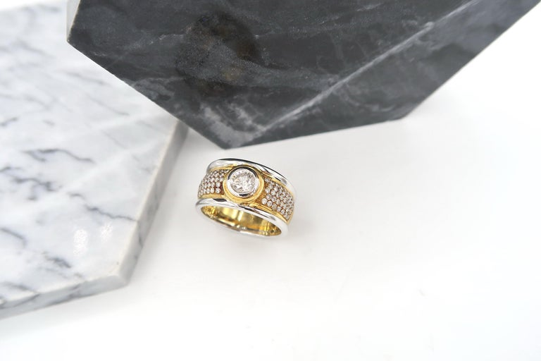 Men's Ring 2-Tone 18 Karat White and Yellow Gold Step Edge Diamond Band Ring  Diamond: 1.27ct. Gold: 18K 14.60g.  Ring size: 57, UK P, US 8  Let us know upon checkout should you wish to have the ring resized.