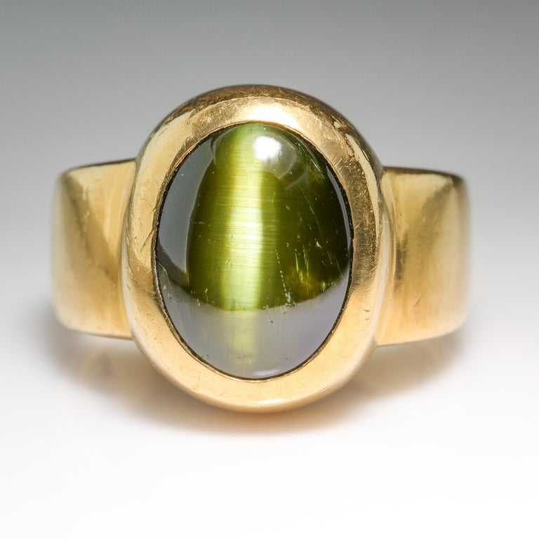 Here's one for the collector of the connoisseur: A large acid green chrysoberyl cat's eye displaying a sharp vertical