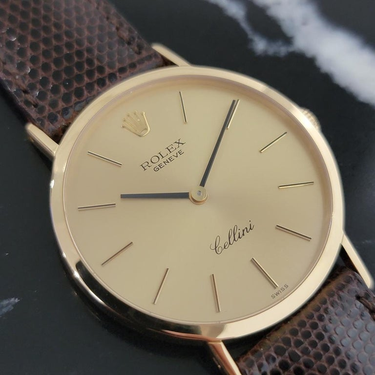 Elegant luxury, Men's 18k solid gold Rolex Cellini 4112 hand-wind dress watch, c.1976. Verified authentic by a master watchmaker. Gorgeous Rolex signed gold dial, applied gold indice hour markers, black minute and hour hands, hands and dial in