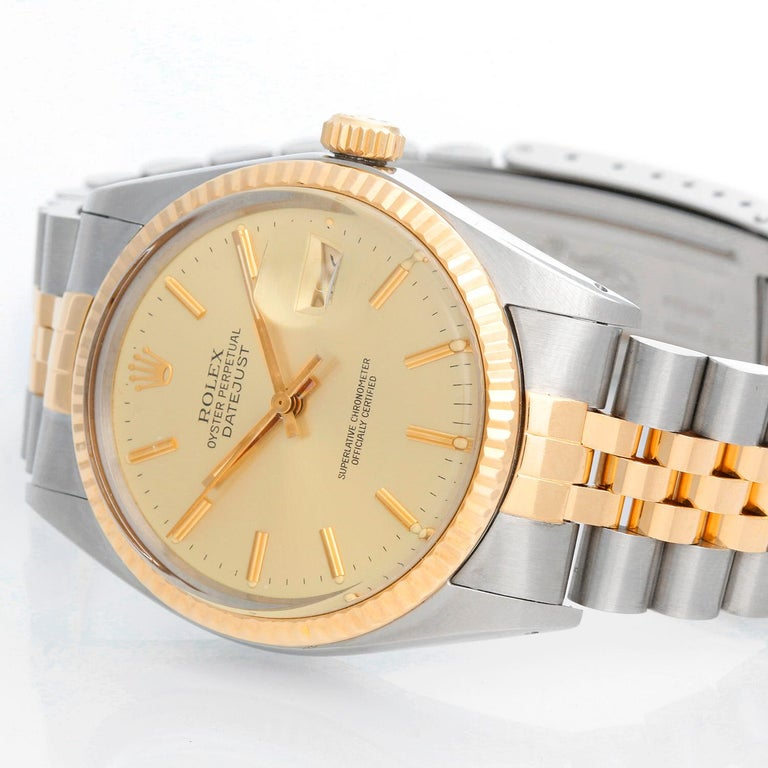 Men's Rolex Datejust 2-Tone Watch 16013 - Automatic winding, 27 jewels, Quickset, acrylic crystal. Stainless steel case with fluted bezel ( 36 mm ). Champagne dial with stick hour markers. Stainless steel and 18k yellow gold Jubilee bracelet.