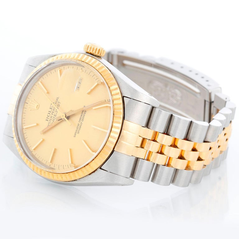 Men's Rolex Datejust 2-Tone Watch 16013 - Automatic winding, 27 jewels, Quickset, acrylic crystal. Stainless steel case with fluted bezel ( 36 mm ). Champagne dial with stick hour markers. Two-tone jubilee bracelet . Pre-owned with custom box.