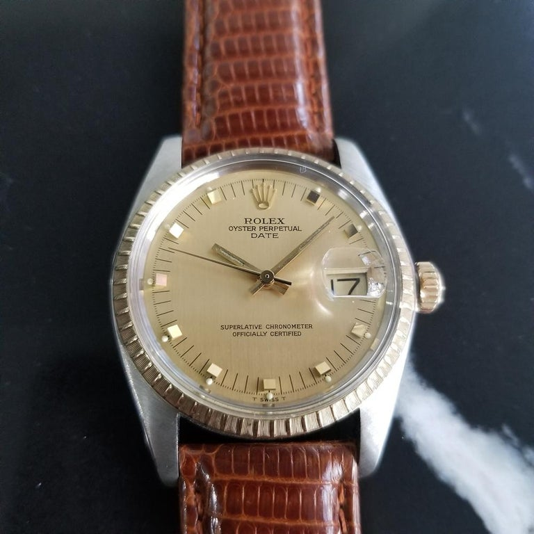Timeless classic, Men's 14k gold & stainless steel Rolex Oyster Perpetual Date Ref.1505 automatic, c.1979. Verified authentic by a master watchmaker. Gorgeous Rolex-signed gold dial, applied indice hour markers, lumed minute and hour hands, sweeping