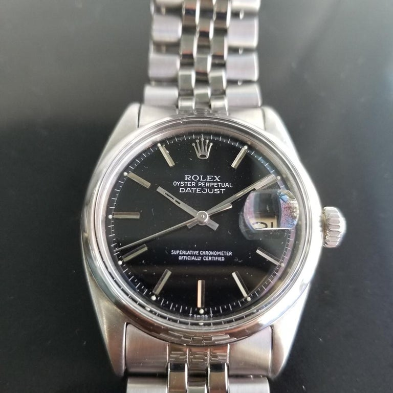 Iconic classic in black, Men's all-stainless steel Rolex Oyster Datejust ref.1601 automatic, c.1968, all original. Verified authentic by a master watchmaker. Gorgeous Rolex signed black dial, applied indice numeral hour markers, minute and hour