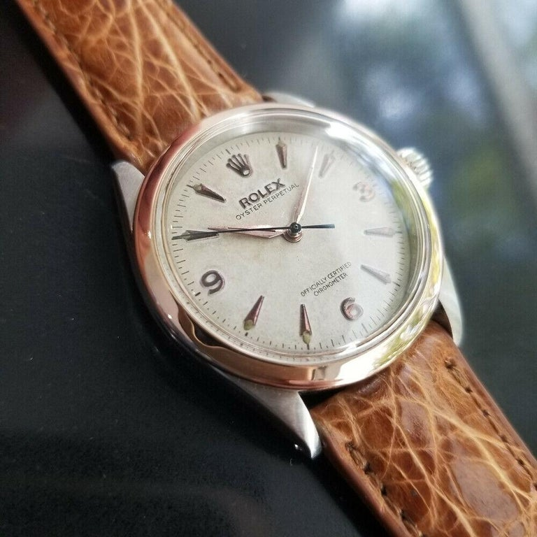 Luxurious icon, Men's Rolex 18k rose gold & stainless steel Oyster Perpetual Ref.6285 automatic dress watch, c.1954. Verified authentic by a master watchmaker. Gorgeous Rolex signed original vintage dial, applied arrowhead and Arabic numeral 3, 6, 9