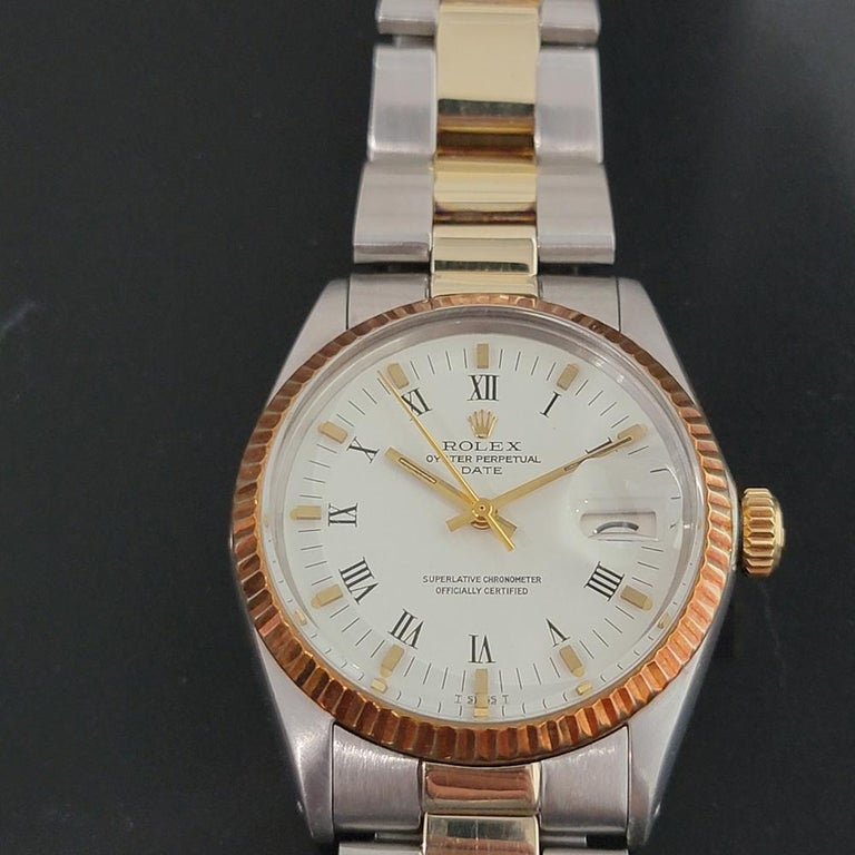 Timeless classic, Men's Rolex Oyster Perpetual Date 1500 automatic with rare rose gold bezel combination, c.1970, all original. Verified authentic by a master watchmaker. Gorgeous Rolex signed white dial, applied gold indice and printed Roman