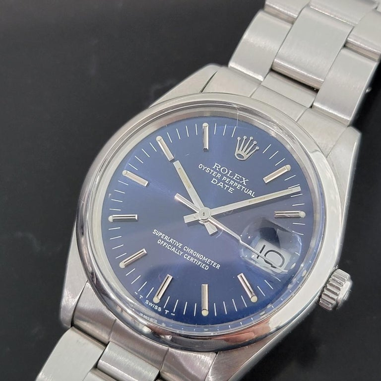 Iconic classic, Men's Rolex Oyster Perpetual Date 15000 automatic, c.1982, all original. Verified authentic by a master watchmaker. Stunning Rolex signed blue dial, applied silver indice hour markers, silver minute and hour hands, sweeping central