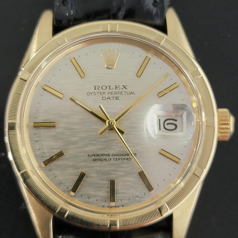 Timeless classic, Men's 14k solid gold Rolex Oyster Perpetual Date Ref.1501 automatic, c.1971. Verified authentic by a master watchmaker. Gorgeous Rolex signed silver textured dial, applied indice, gilt minute and hour hands, sweeping central second