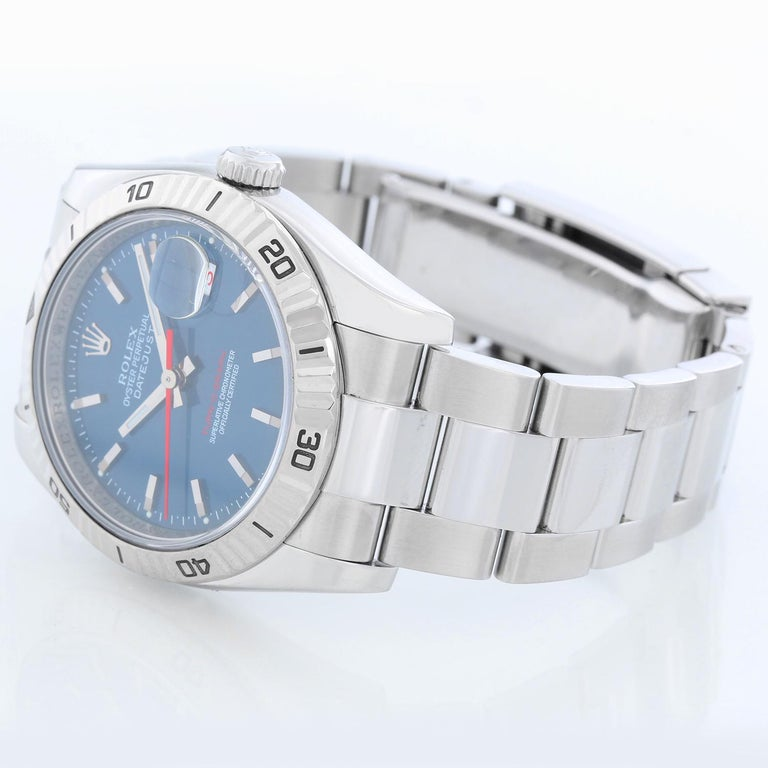 Men's Rolex Turnograph Datejust Stainless Steel Watch 116264 - Automatic winding, 31 jewel, sapphire crystal. Stainless steel case with 18k white gold Thunderbird bezel  (36mm diameter). Blue dial with stick markers; red date and second hand.