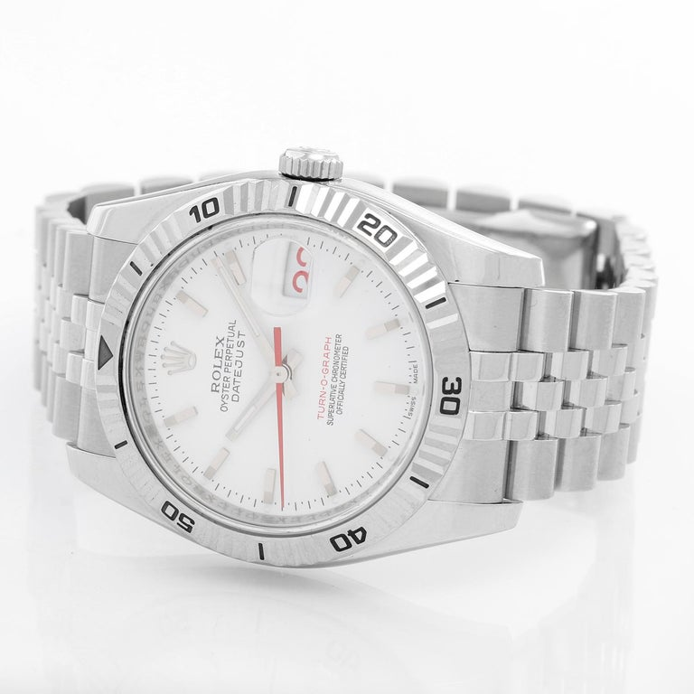 Men's Rolex Turnograph Datejust Stainless Steel Watch 116264 - Automatic winding, 31 jewel, sapphire crystal. Stainless steel case with 18k white gold Thunderbird bezel  (36mm diameter). White dial with stick markers; red date and second hand.