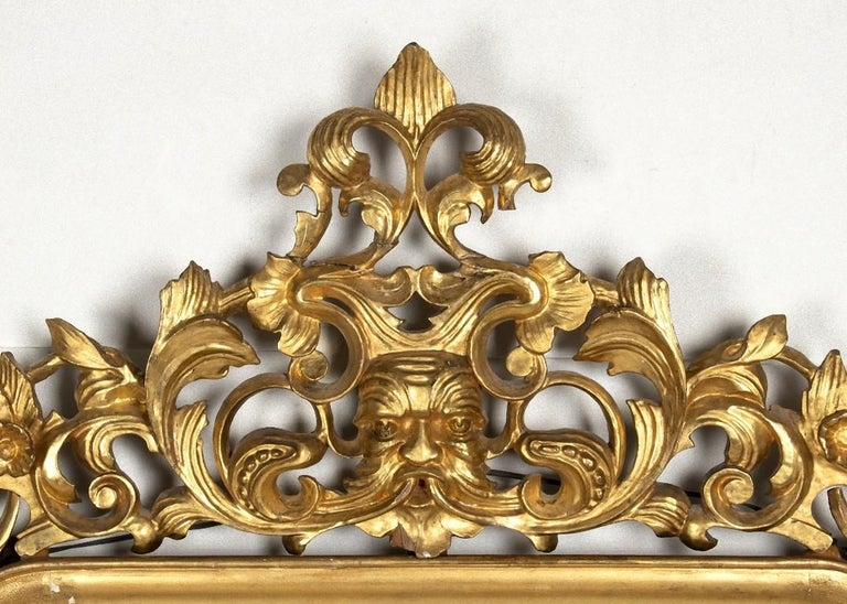 This Mercury mirror is a precious decorative object realized in Rome, Italy during the mid-19th century.  It is a splendid and rare mercury mirror with frame in carved and gilded wood.  Dimensions: cm 110 x 190.  In very good conditions,