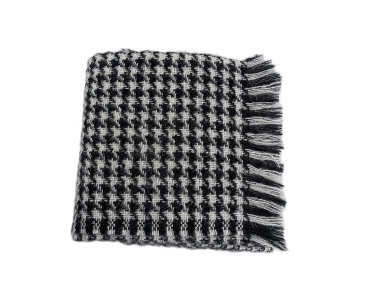 Houndstooth mohair blend throw. Mohair and wool with a touch of nylon. Made in South Africa.