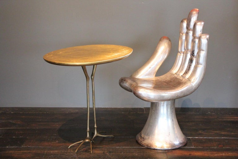 Wonderful patinated Méret Oppenheim for Simon Gavina, 'Traccia' table, in bronze, gold leaf and wood, Italy, circa 1972.