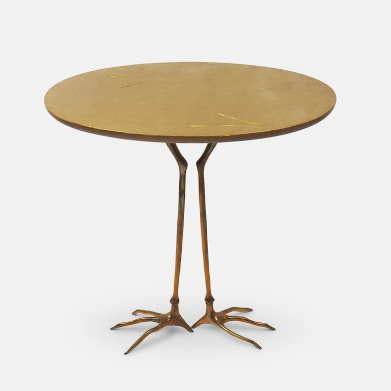 Meret Oppenheim 'Traccia' table produced for Studio Simon's Collezione Ultramobili , Dino Gavina, Milan, circa 1972.  The tabletop is in gold leaf with the characteristic bird tracks impressed on the surface, the underside is painted with deep