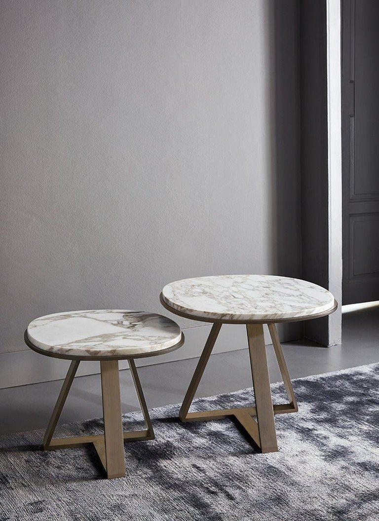 Meridiani Judd - Editions shine low table designed by Andrea Parisio  Meridiani Editions - Shine  Calacatta gold marble top  Metal base with a bronzed brass varnish.  This product is currently on showroom display.