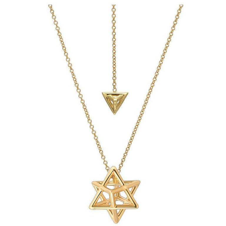 The Merkaba 18K yellow gold necklace, is a heirloom-quality, sacred geometric three dimensional jewelry piece, highlighting superb attention to detail and extraordinary polish, symmetry and equilibrium. It suspends elegantly at the chest, measuring