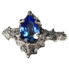 Mermaid Tanzanite and 18 Karat White Gold Diamond Ring