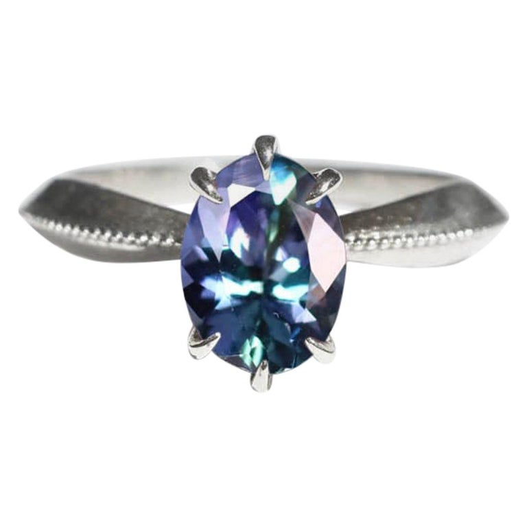Mermaid Tanzanite Vintage Inspired Tapered 18 Karat White Gold Solitaire Ring For Sale