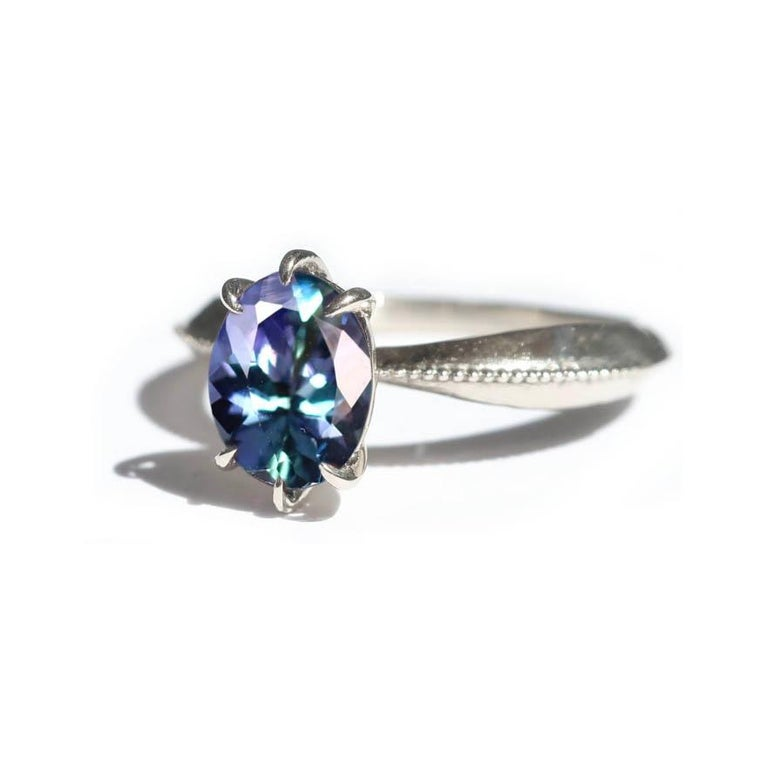 Oval Cut Mermaid Tanzanite Vintage Inspired Tapered 18 Karat White Gold Solitaire Ring For Sale