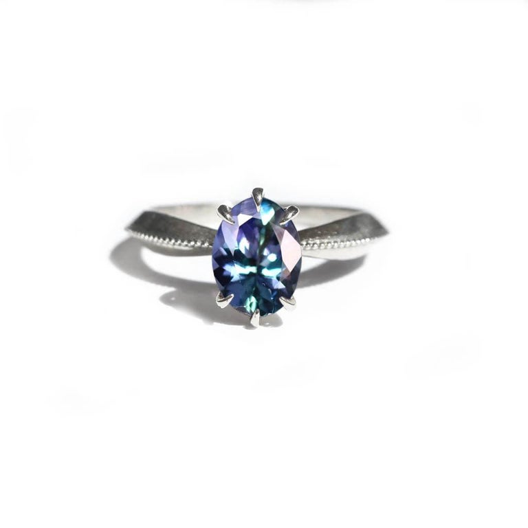 Mermaid Tanzanite Vintage Inspired Tapered 18 Karat White Gold Solitaire Ring In New Condition For Sale In Foxborough, MA