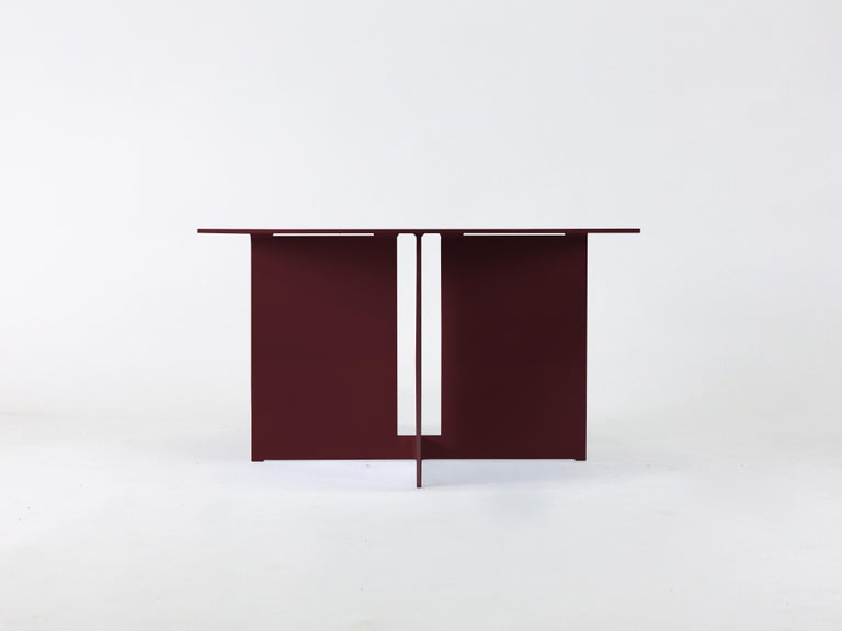 The Mers coffee table  is fabricated from solid aluminum and is suitable for use indoors and out. Form is inspired by the simple utilitarianism of West Coast aluminum fishing boats.  Shown in aluminum with Burgundy powdercoat.  Overall dimensions: