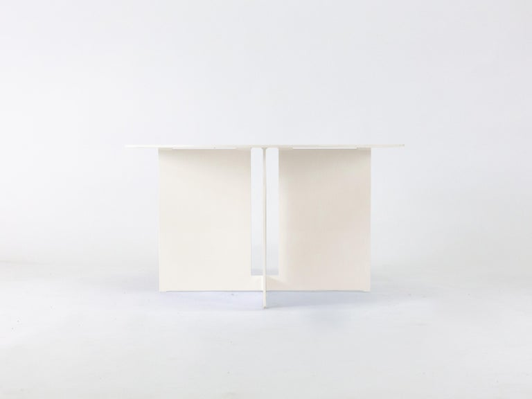 The Mers coffee table  is fabricated from solid aluminum and is suitable for use indoors and out. Form is inspired by the simple utilitarianism of West Coast aluminum fishing boats.  Shown in aluminum with cream powdercoat.  Overall dimensions: 30