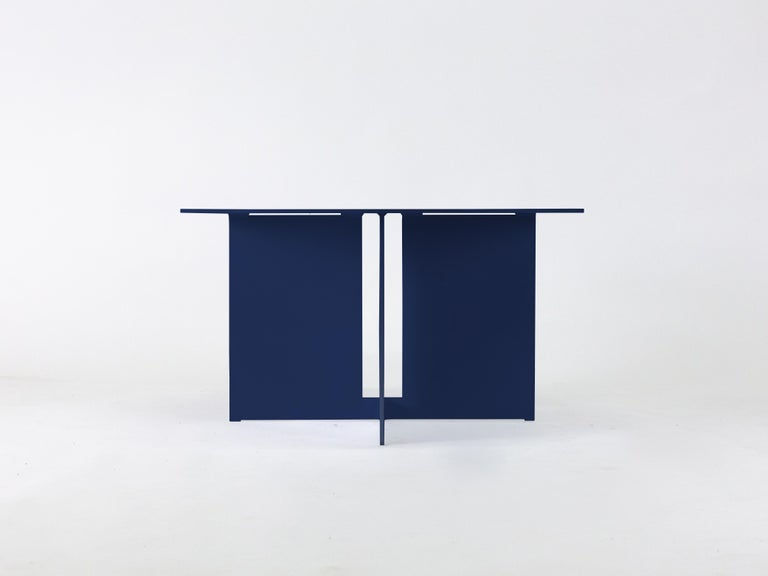 The Mers coffee table is fabricated from solid aluminum with powdercoat finish. It is suitable for use indoors and out.   Shown in aluminum with pacific blue powdercoat.  Overall dimensions: 30