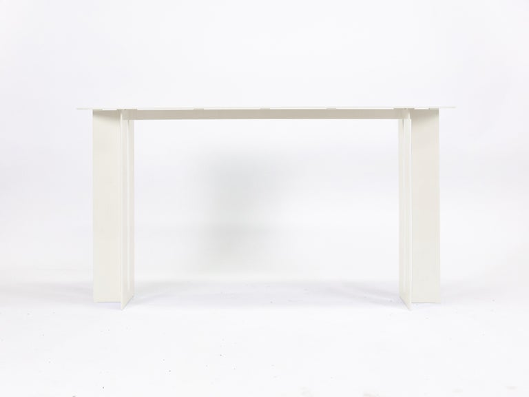 The Mers console table is fabricated from solid aluminum and is suitable for use indoors and out. Form is inspired by the simple utilitarianism of West Coast aluminum fishing boats.  Shown in aluminum with powdercoat finish. Custom sizing and