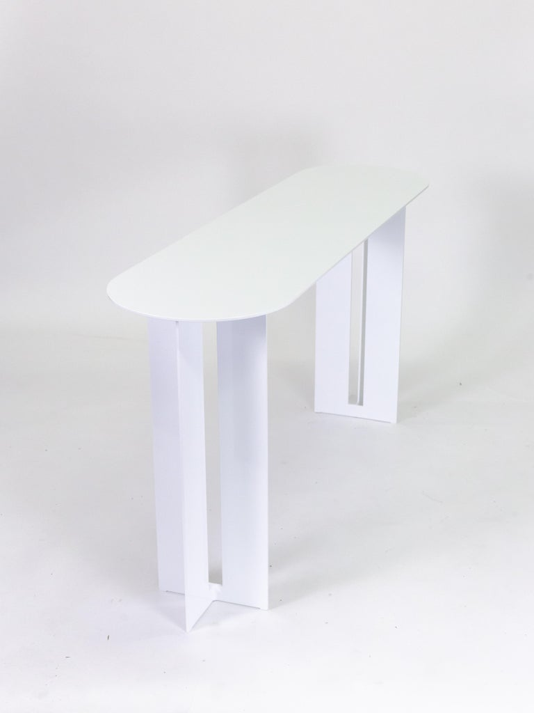 The Mers console table is fabricated from solid aluminum and is suitable for use indoors and out. Form is inspired by the simple utilitarianism of West Coast aluminum fishing boats.  Shown in aluminum with White powdercoat finish. Custom sizing and