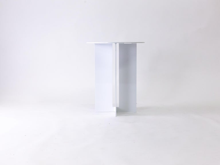 The Mers side table is fabricated from solid aluminum with powdercoat finish. It is suitable for use indoors and out.   Shown in aluminum with powdercoat finish. Custom sizing and powdercoat color available.  Overall dimensions: 19
