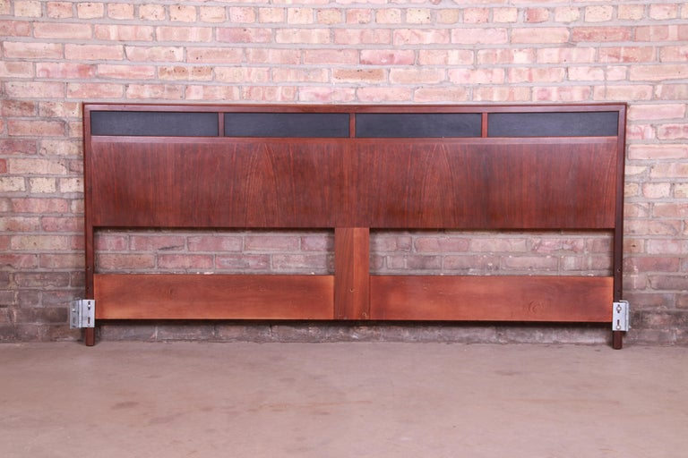 A gorgeousMid-Century Modern king size headboard  By Merton Gershun for Dillingham  USA, 1960s  Book-matched walnut, with inset black vinyl panels.  Measures: 77.25
