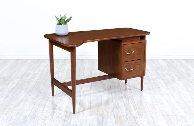 Merton L. Gershun walnut writing desk for American of Martinsville.