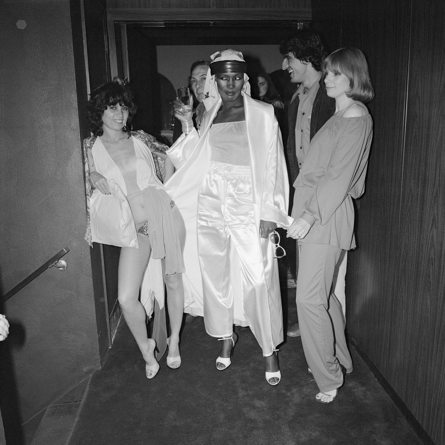 Grace Jones in Hallway with JudiJupiter and Others on Opening Night Le Farfalle