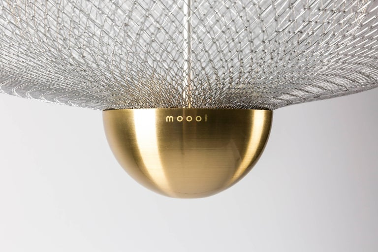 Meshmatics was designed by Rick Tegelaar for Moooi and is created from a special machine process that stretches the wire mesh with precision and accuracy to create its light and beautiful structure. The pattern of the structure is cast onto the