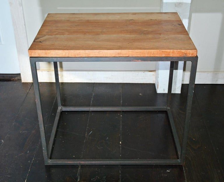 Iron metal frame geometric side or end table with teakwood top. Appropriate for indoor or outdoors use.