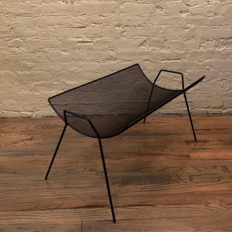 Mid-Century Modern, scooped, metal mesh, magazine rack by Sol Bloom for New Dimensions.