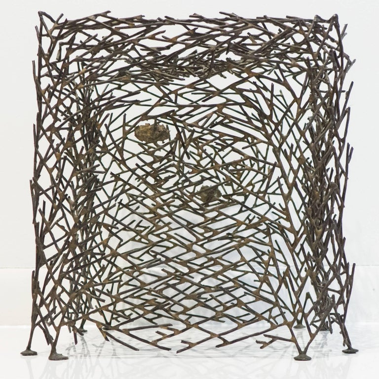 Freestanding cast and hand-collaged sculpture of sulphur bronze and silver by Boston-area artist Richard Filipowski. A densely textured, naturalistic form in the shape of a footed cube. A favorite student of Moholy-Nagy in Chicago, Filipowski went